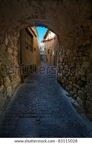 The Narrow Street in the Medieval Town in France - stock photo