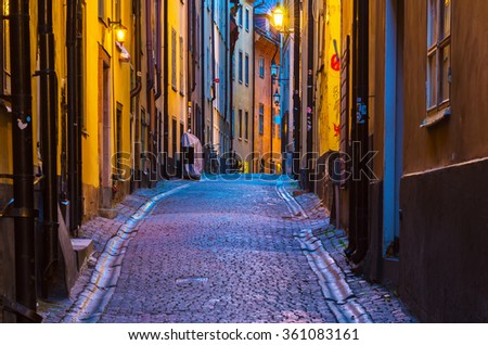 The narrow street of Gamla Stan - historic city old center of Stockholm, at summer night, with lanterns - stock photo