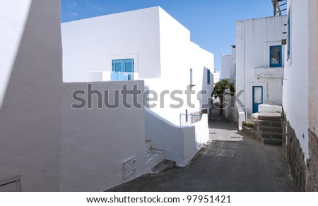 The narrow street with white buildings, the  island of Panarea