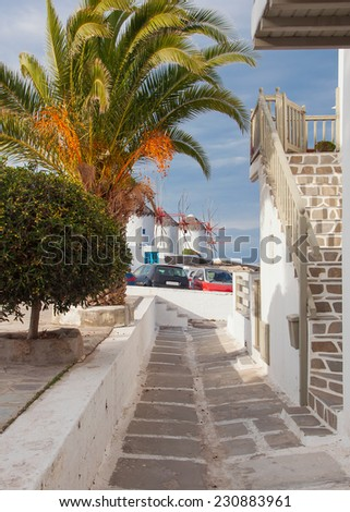 The narrow streets leading to the famous windmills on the island of Mykonos - beautiful and typical of the Greek island - stock photo