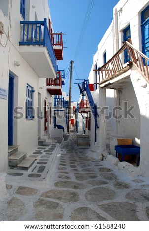 The narrow streets on the island of Mykonos, typical of the Greek island, greek colours - stock photo