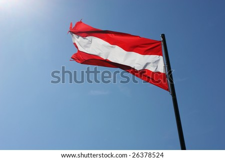 The national flag of Austria waving in the wind - stock photo