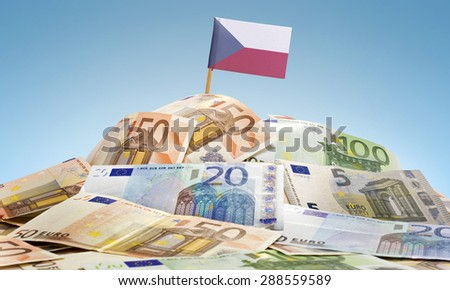 The national flag of Czech Republic sticking in a pile of mixed european banknotes.(series) - stock photo