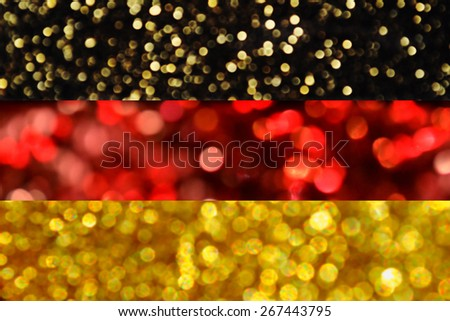 The National flag of Germany made of bright and abstract blurred backgrounds with shimmering glitter - stock photo