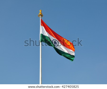 The National Flag of India is a horizontal rectangular tricolour of deep saffron, white and green; with the Ashoka Chakra, a 24-spoke wheel, in navy blue at its centre. - stock photo