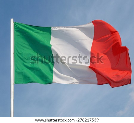 The national flag of Italy, Europe over blue sky - stock photo