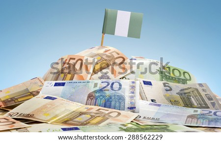 The national flag of Nigeria sticking in a pile of mixed european banknotes.(series) - stock photo