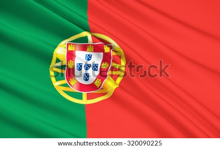 The National Flag of Portugal with emblem - stock photo