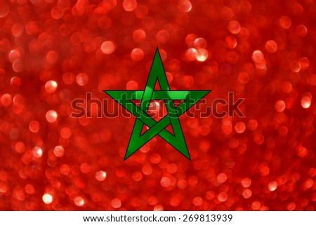 The National flag of the Kingdom of Morocco made of bright and abstract blurred backgrounds with shimmering glitter - stock photo