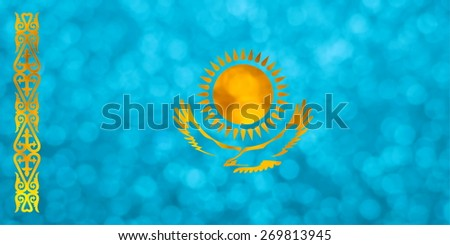 The National flag of the Republic of Kazakhstan made of bright and abstract blurred backgrounds with shimmering glitter - stock photo