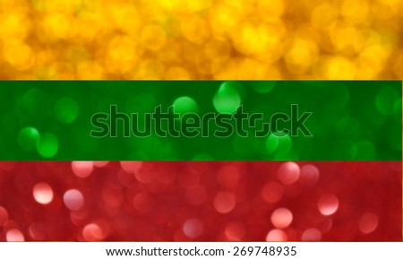 The National flag of the Republic of Lithuania made of bright and abstract blurred backgrounds with shimmering glitter - stock photo