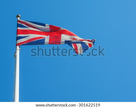 The national flag of United Kingdom, Europe floating in the wind over blue sky