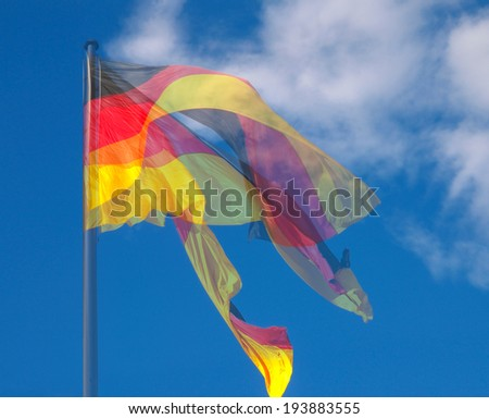 The national German flag of Germany floating in the wind