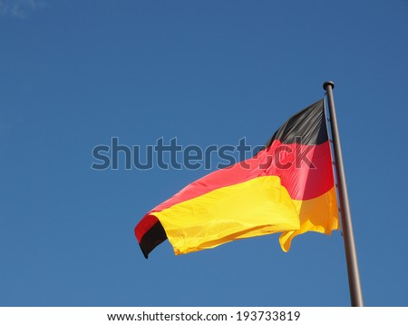The national German flag of Germany over blue sky