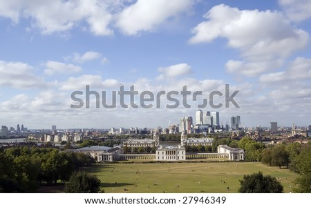 The National Maritime Museum (former Royal Naval College) and the Queen's House at Greenwich, with Canary Wharf and the East End across the River Thames. - stock photo