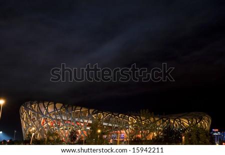The National Olympic Stadium Bird's Nest night scenes in Beijing of China - stock photo