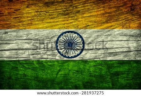 The national vintage flag of India on wooden surface - stock photo