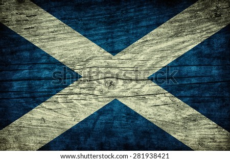 The national vintage flag of Scotland on wooden surface - stock photo