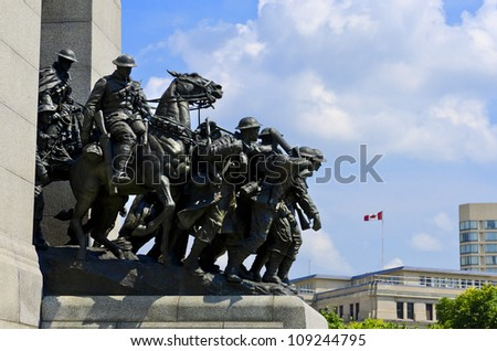 The National War Memorial known as The Response, is a granite cenotaph with bronze sculptures of 23 figures in war. - stock photo