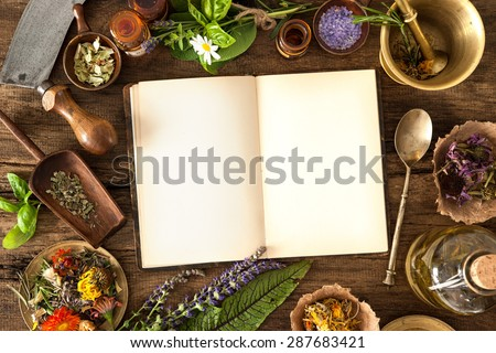 The natural medicine, herbal, medicines and old book with copy space for your text - stock photo