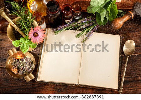 The natural medicine, herbal, medicines and old recipe book with copy space for your text - stock photo