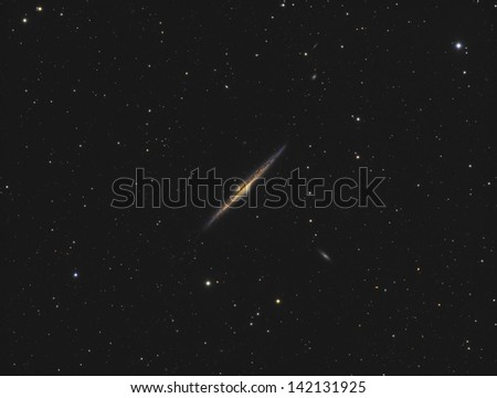 The Needle Galaxy (NGC4565) - An edge-on spiral galaxy about 42 million light years away in the constellation Coma Berenices - stock photo