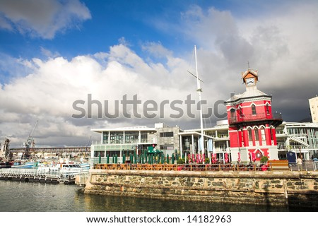 The Nelson Mandela Gateway to Robben Island and Clocktower at the Cape town Waterfront in South Africa - stock photo