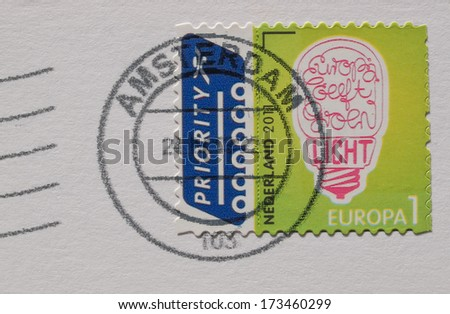 THE NETHERLANDS - CIRCA 2011: A stamp printed in the Netherlands reading Europa geeft groene (Europe gets green) with postage meter from Amsterdam - stock photo