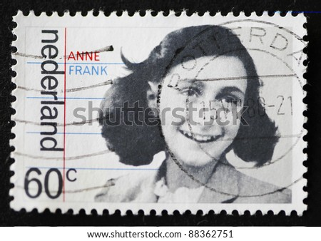 """THE NETHERLANDS - CIRCA 1980: A stamp printed in The Netherlands shows image of Anne Frank with the inscription """"Anne Frank"""", series, issued circa 1980 - stock photo"""