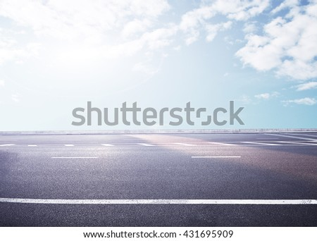 The new asphalt highway is under the blue sky - stock photo