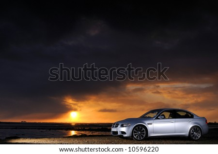 The new BMW M3 Saloon at sunrise - stock photo