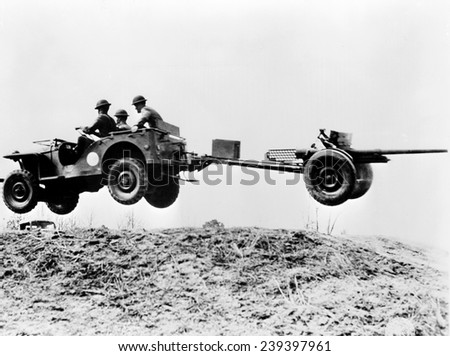 The new 'jeep' in mid-air as it pulls a small artillery piece ca.1941