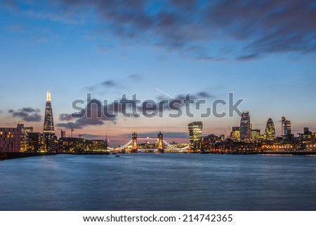 The new London skyline at night with The Shard, Tower Bridge and the new skyscrapers of The City.