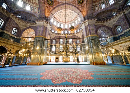 The New Mosque (Yeni Valide Camii), an Ottoman Imperial Mosque interior architecture in Istanbul, Turkey, Eminonu district - stock photo