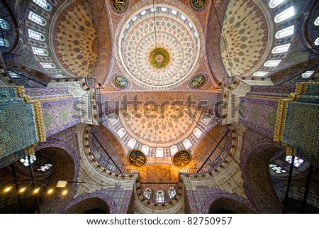 The New Mosque (Yeni Valide Camii, Ottoman Imperial Mosque), impressive interior ceiling architecture in Istanbul, Turkey - stock photo