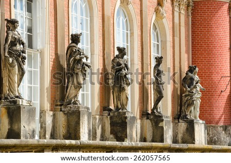 The New Palace is a palace situated in Sanssouci Royal Park in Potsdam, Germany. The building was begun in 1763 under Frederick the Great and was completed in 1769. - stock photo