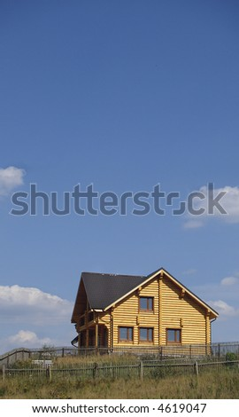 The new rural house behind an old fencing - stock photo