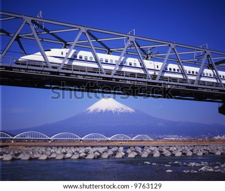 The New Shinkansen runs over Mt,Fuji peak - stock photo