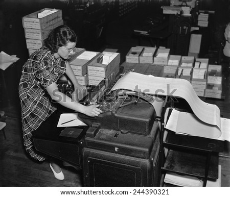 The new Social Security Administration was challenged with handling an unprecedented amount of information to track citizens' wage records and taxes paid Ca. 1937. - stock photo