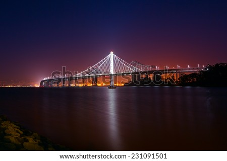 The new span of the Bay Bridge with Treasure Island and Oakland in the background  - stock photo