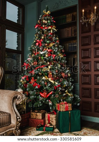 the New Year's fir-tree is decorated with toys - stock photo