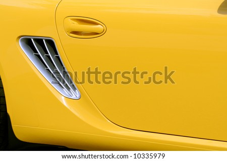 The new yellow car, side view 3 - stock photo