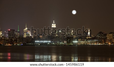 The New York City mid-town skylines at night  - stock photo