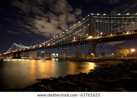 The New York City skyline at twilight w Manhattan Bridge - stock photo