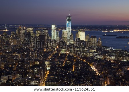 The New York City skyline at twilight w the Freedom tower - stock photo