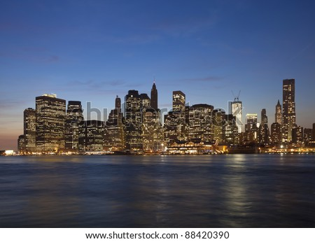 The New York City skyline at twilight with the Freedom tower - stock photo