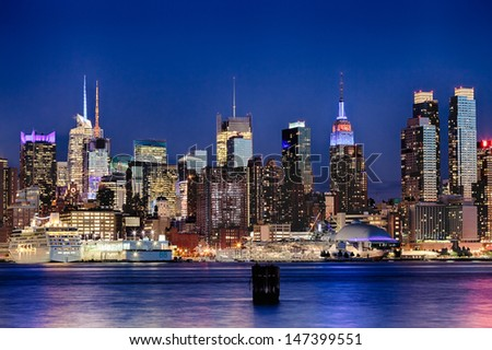 The New York City Uptown w Intrepid sea, air and space museum in the night - stock photo