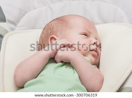 The newborn one-month baby lies - stock photo