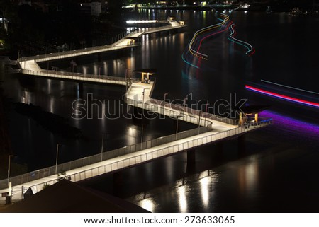 The Newfarm Riverwalk in Brisbane, Queensland, Australia. A scenic place to walk along or ride your bike with views of the Story Bridge and Brisbane City. - stock photo