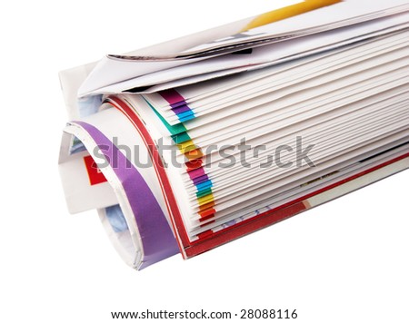 The newspaper curtailed into a tube on a white background.
